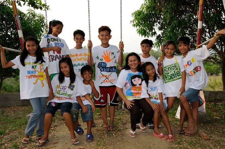 Cecilia with children from a community vulnerable to trafficking.