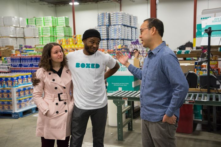 Boxed CEO Chieh Huang, right, surprised employee Marcel Graham and his fiancee, Tara Aucoin, with the news that the