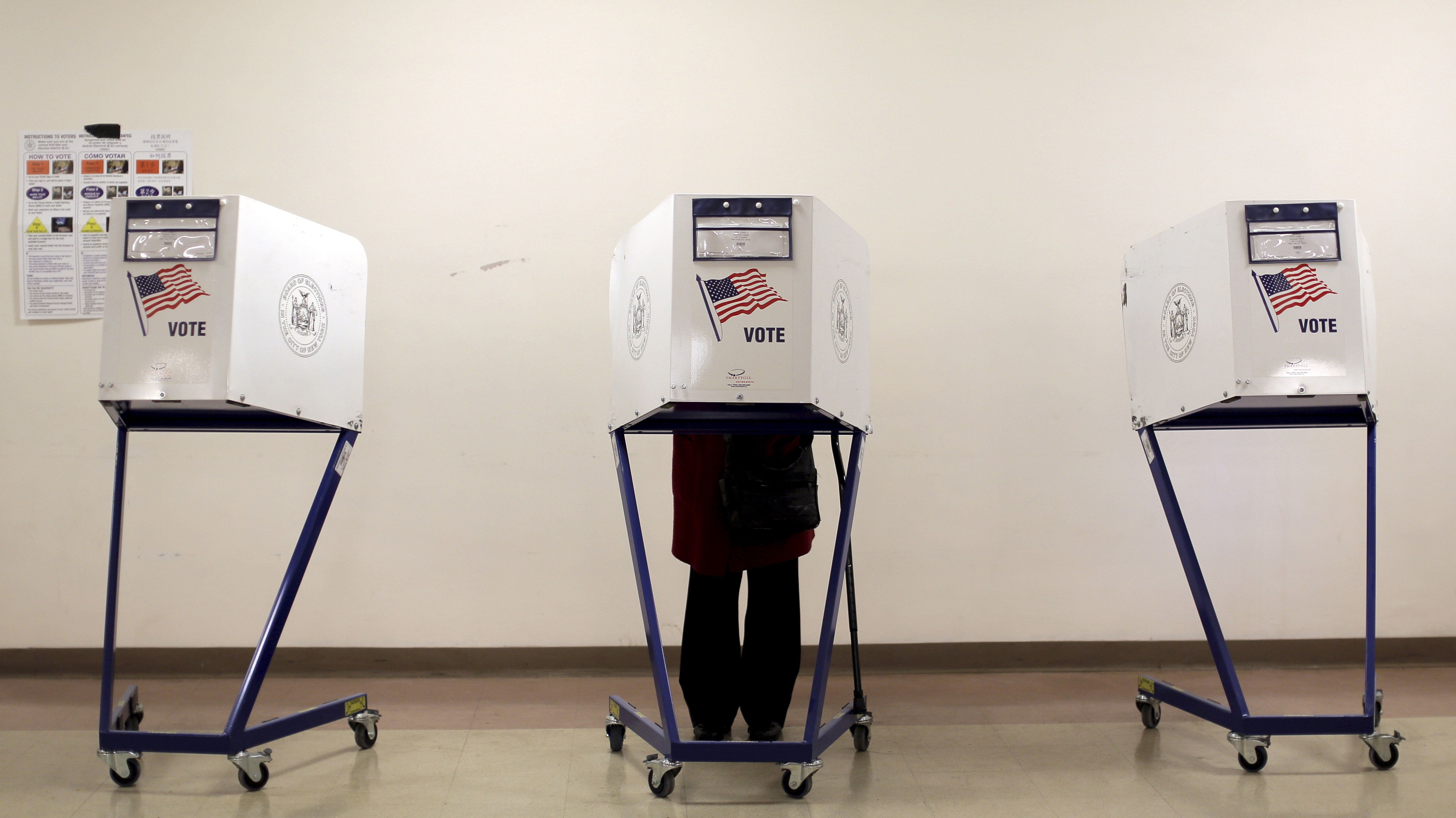 "A voter is seen at a polling station during the New York primary elections in the Manhattan borough of New York City, U.S., April 19, 2016. Nearly half of Americans believe that the system that U.S. political parties use to pick their candidates for the White House is ""rigged"" and two-thirds want to see the process changed, according to a Reuters/Ipsos poll. REUTERS/Brendan McDermid/File Photo"