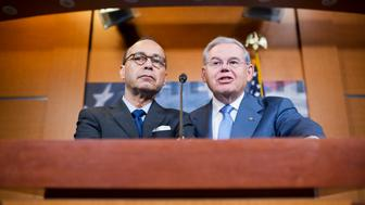 UNITED STATES - MAY 26: Rep. Luis Gutierrez, D-Ill., left, and Sen. Bob Menendez, D-N.J., conduct news conference in the Capitol Visitor Center on the Puerto Rico Oversight, Management, and Economic Stability Act, which is meant to alleviate the country's debt, May 26, 2016. (Photo By Tom Williams/CQ Roll Call)