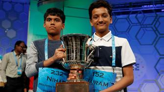 Co-champions Nihar Saireddy Janga (L) and Jairam Jagadeesh Hathwar hold their trophy upon completion of the final round of Scripps National Spelling Bee at National Harbor in Maryland, U.S. May 26, 2016.  REUTERS/Kevin Lamarque