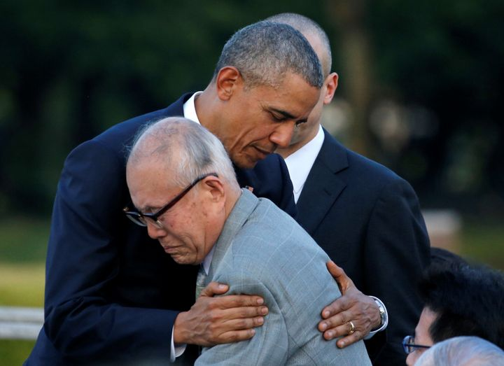 President Barack Obama hugs with atomic bomb survivor Shigeaki Mori as he visits Hiroshima Peace Memorial Park in Hiroshima,