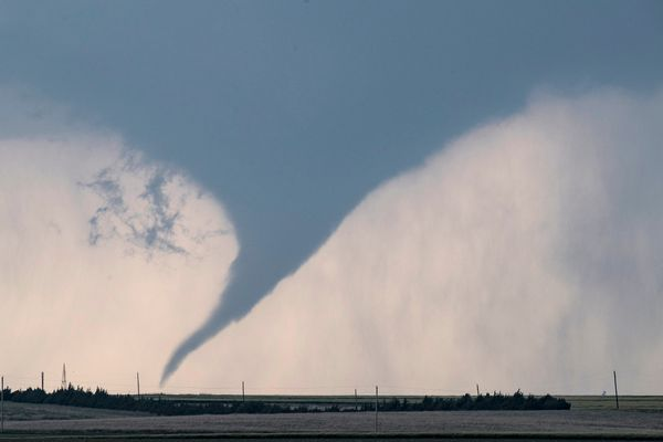 A tornado is seen south of Dodge City, Kansas, moving north on May 24, 2016.