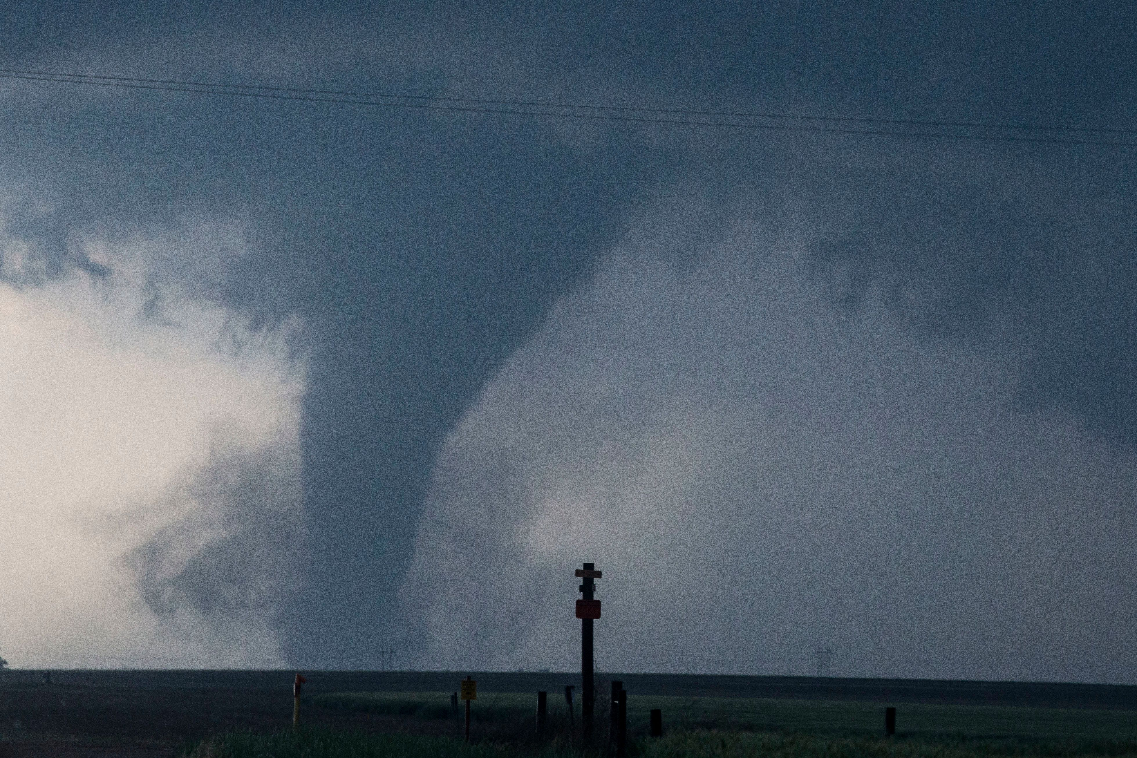 DODGE CITY, KS - MAY 24: A tornado is seen South of Dodge City, Kansas moving North on May 24, 2016 in Dodge City, Kansas.  About 30 tornadoes were reported on Tuesday in five different states from Michigan to Texas. Damage to homes and property was also reported in Ford County, Kansas. (Photo by Brian Davidson/Getty Images)