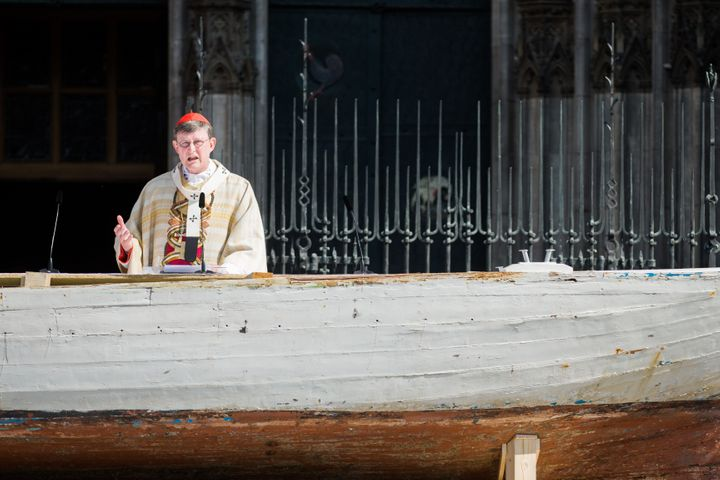 Cardinal and archbishop Rainer Maria Woelki conducts the Corpus Christi Mass from a seven-meter-long refugee boat on May 26,