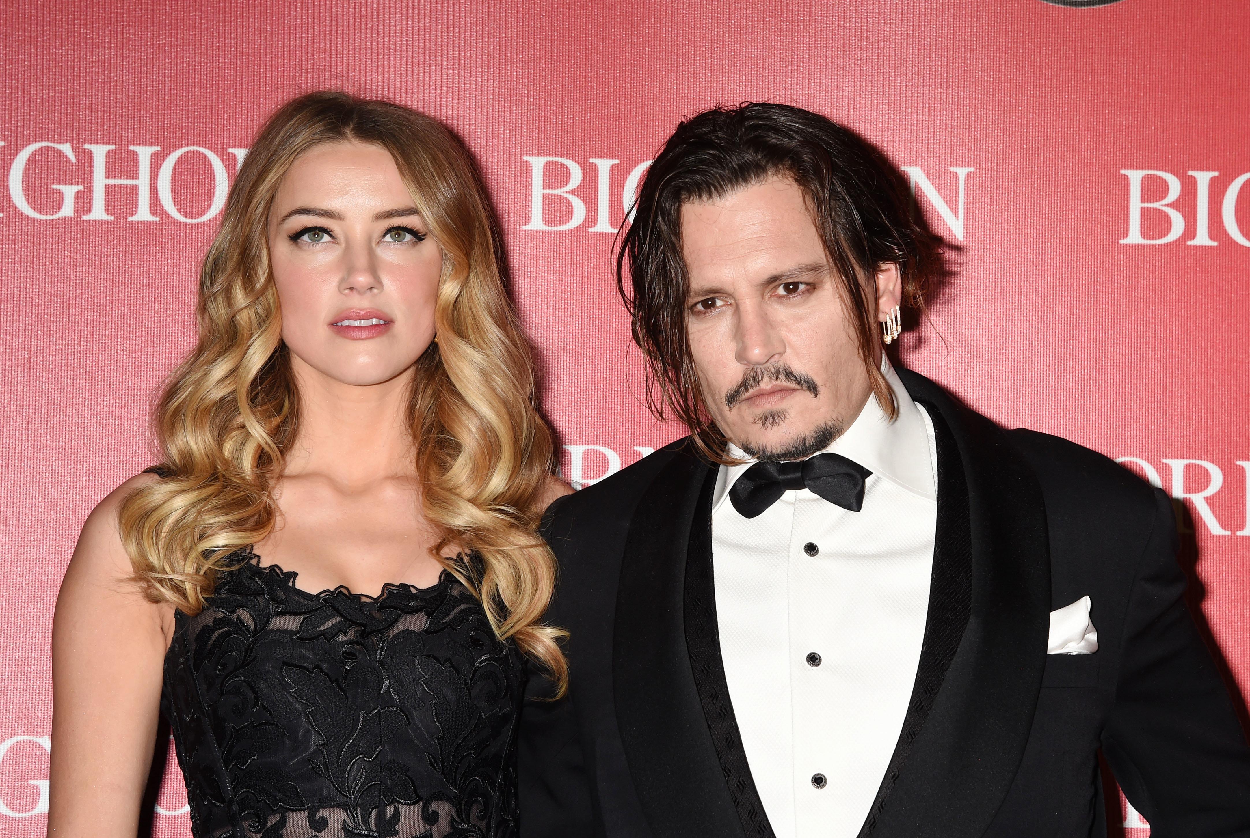 Amber Heard Granted Restraining Order Against Johnny