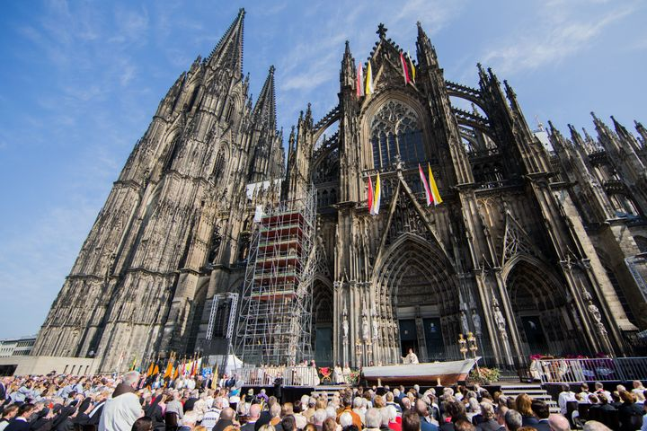 Crowds gather outside Germany's Cologne Cathedral for the Corpus Christi Mass.