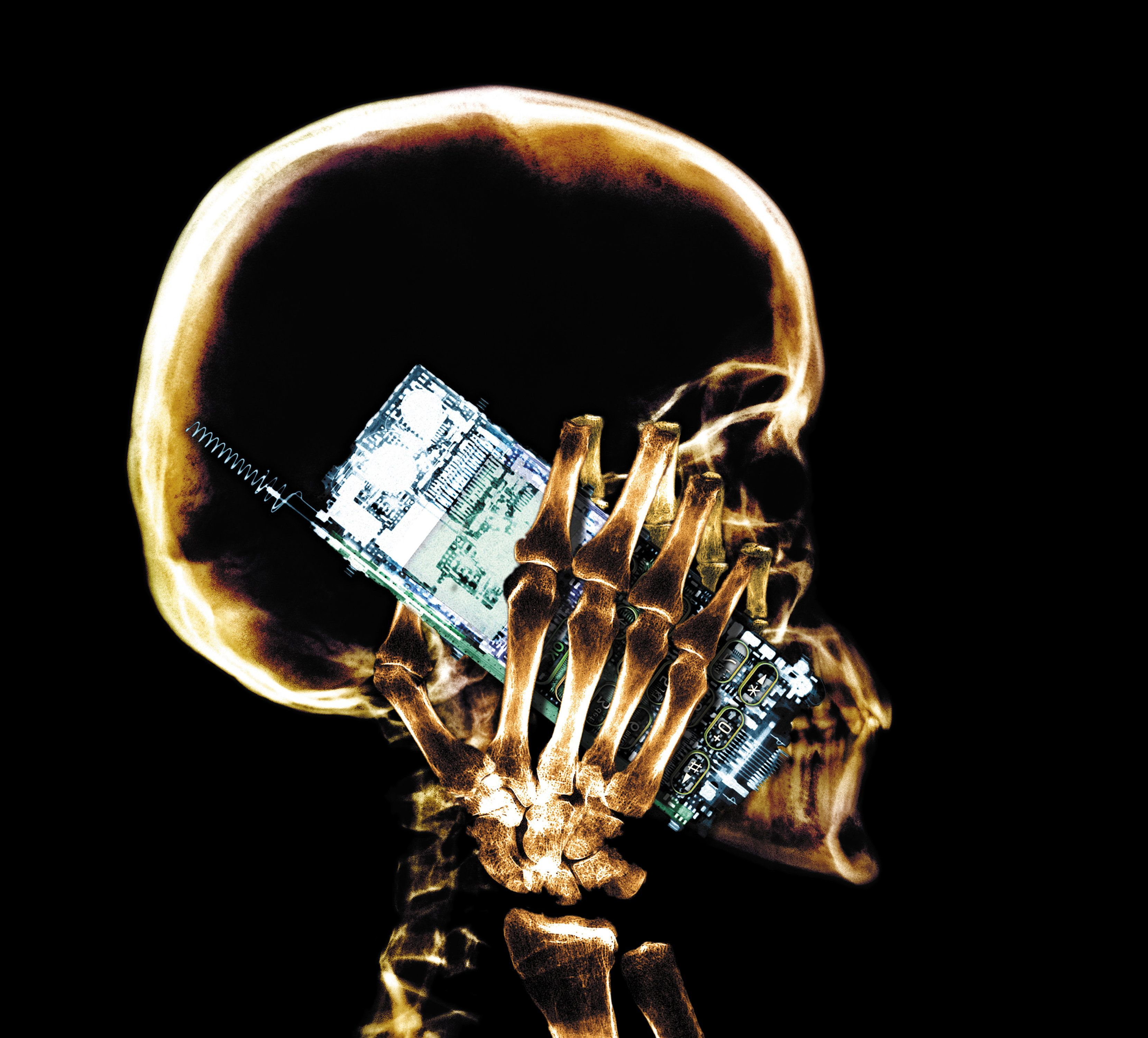 Skull holding cell phone to mouth