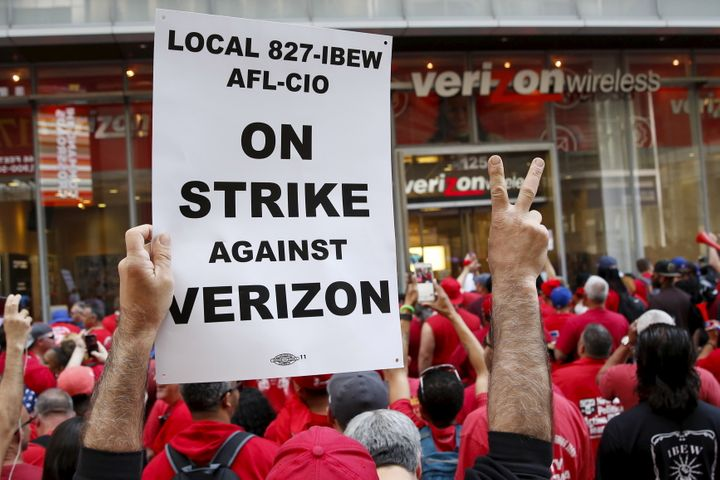 People demonstrate outside a Verizon wireless store in New York on April 18, 2016.