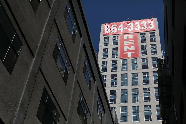 A banner advertising units for rent hangs on the side of an apartment building in San Francisco. San Francisco is t