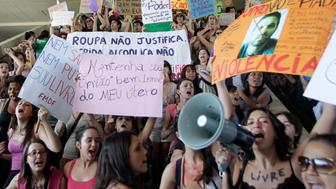 "Women take part in the ""Marcha das Vagabundas"" (Slutwalk) protest in Brasilia June 18, 2011. The demonstrators are protesting against sexism, rape and sexual crimes following similar recent demonstrations in Canada after a Toronto policeman suggested in January that women could avoid sexual assault by not dressing like a ""slut."" REUTERS/Ueslei Marcelino (BRAZIL - Tags: POLITICS CIVIL UNREST SOCIETY)"