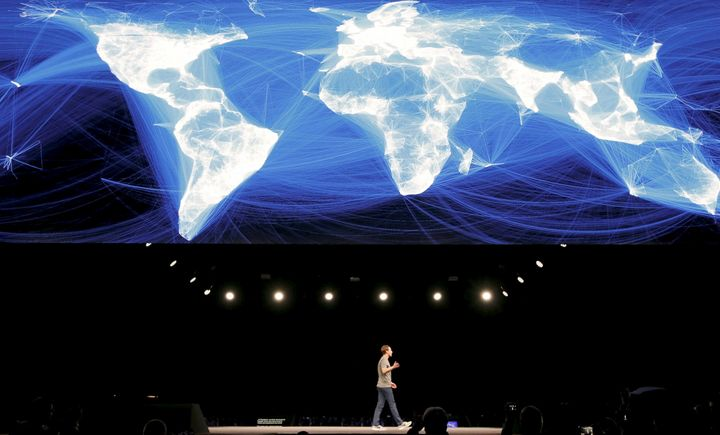 Facebook CEO Mark Zuckerberg appears below an illustration showing how his social network connects the world.