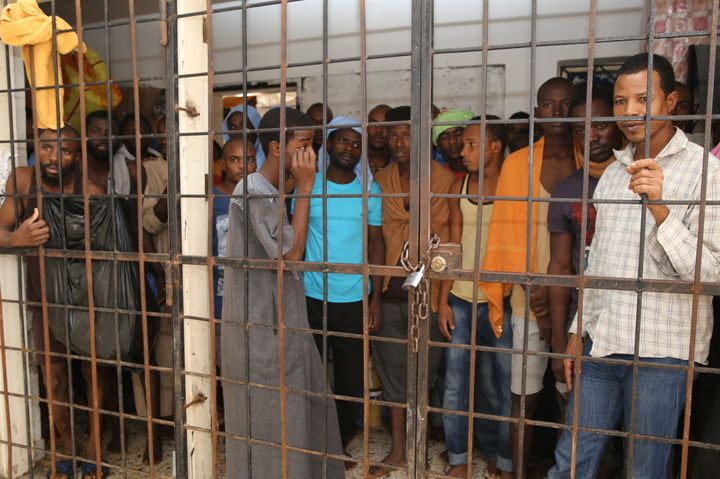 Refugees are seen at a makeshift detention center in the outskirts of Misrata, Libya, last October. Incarcerated migrants rep