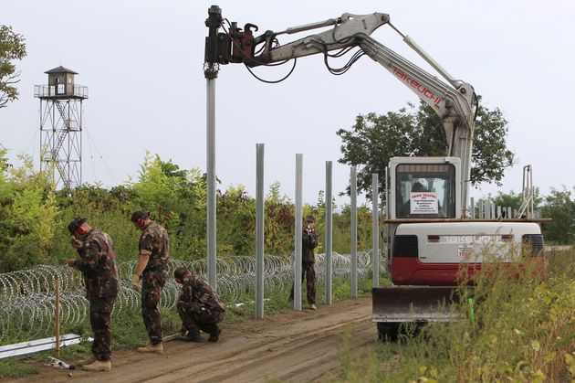 Hungarian soldiers erect a fence on the border with Croatia in September.European measures to stem...