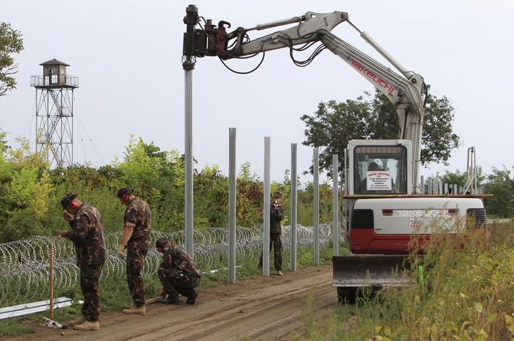 Hungarian soldiers erect a fence on the border with Croatia in September. European measures to stem the flow of migrants