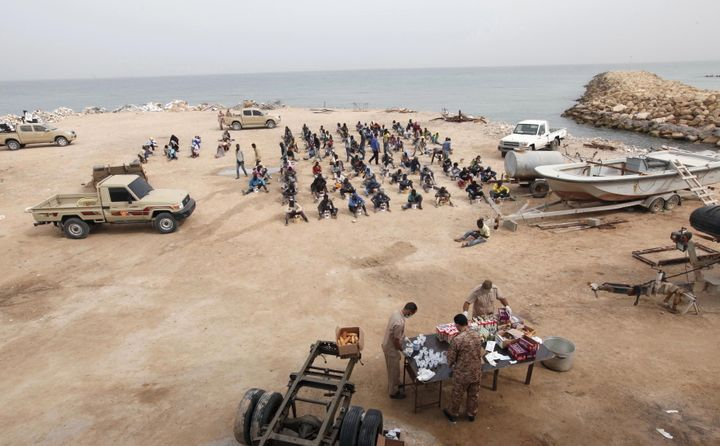 Migrants who attempted to flee to Europe are held at the coastguard center in the coastal city of Tripoli in October.