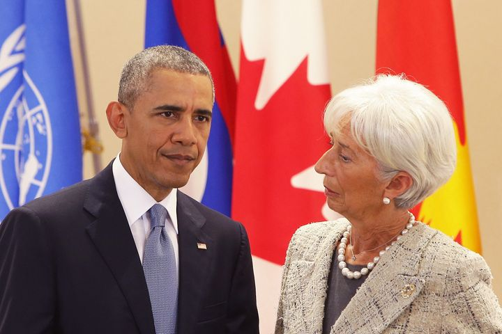 IMF managing director Christine Lagarde speaks with President Barack Obama at the G-7 conference. Critics argue that the