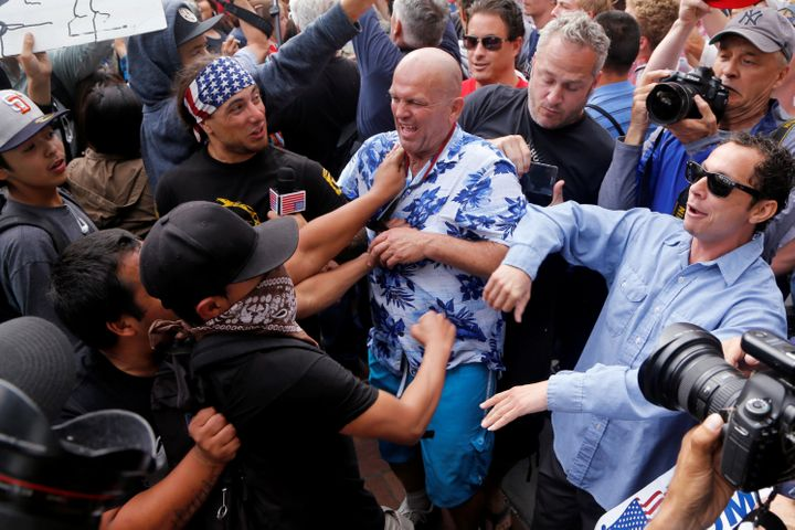 Donald Trump supporters and anti-Trump demonstrators clash outside a campaign event for in San Diego on Friday.