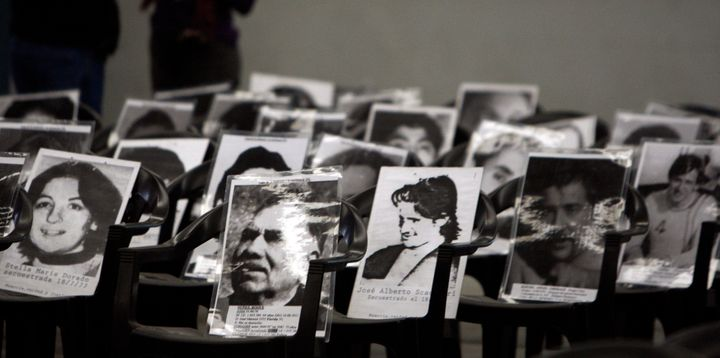 Pictures of those who disappeared during Argentina's 1976-83 military dictatorship are seen placed on chairs during a 2010&nb