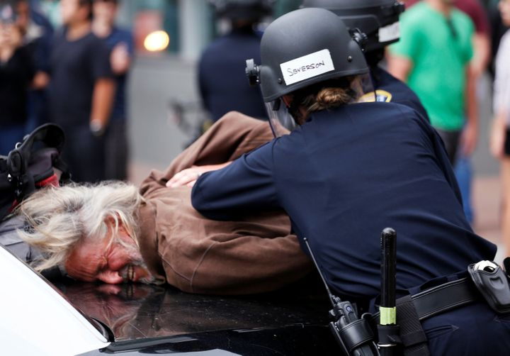 A man is arrested during a demonstration against Republican candidate Donald Trump outside his campaign event in San Diego, C