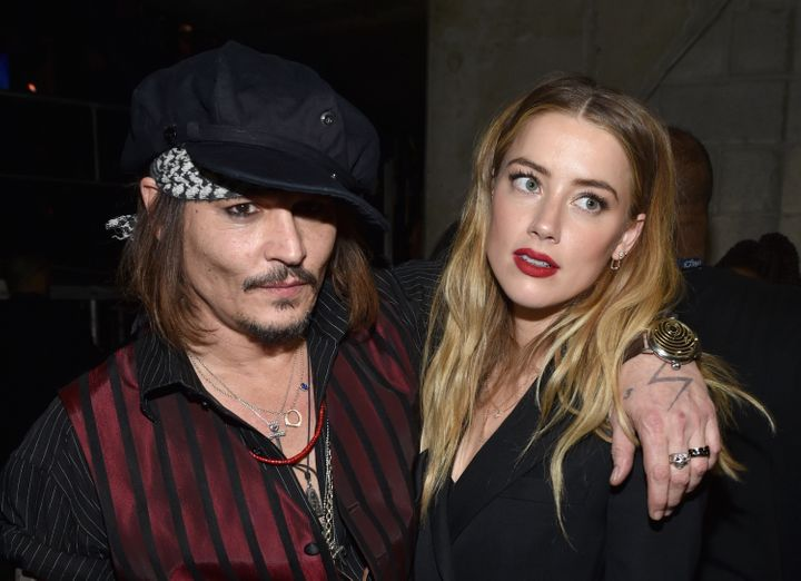 Johnny Depp and Amber Heard attend the 2015 Grammy Awards together.