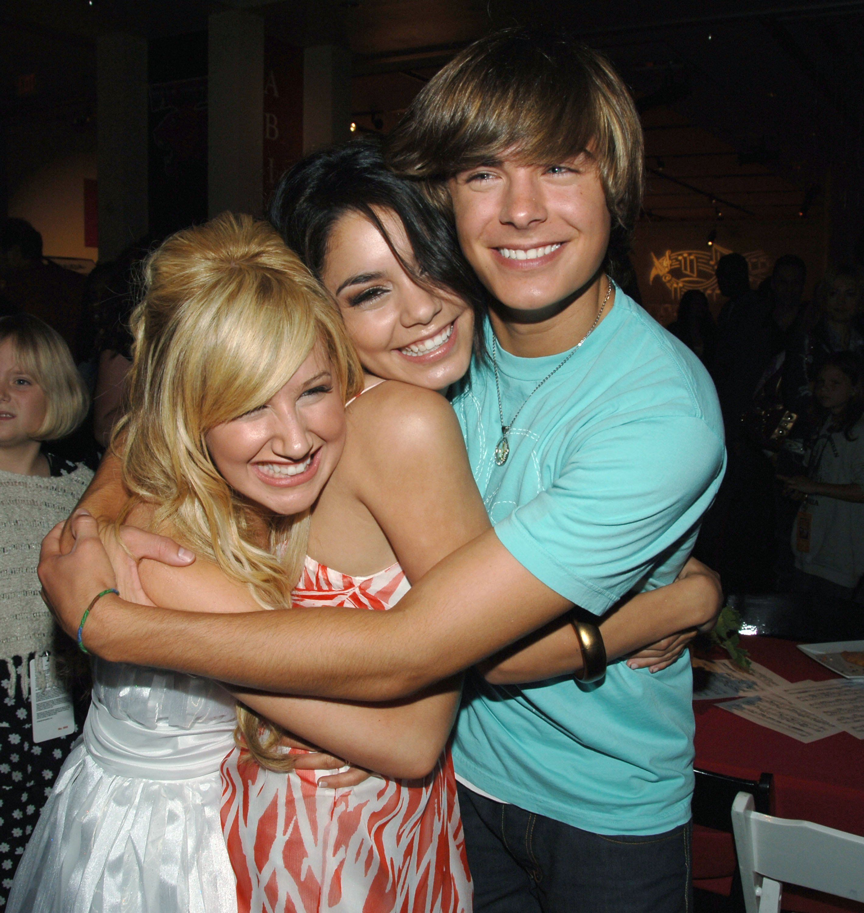 HOLLYWOOD - MAY 13:  (L-R)  Actors Ashley Tisdale, Vanessa Anne Hudgens and Zac Efron attend the after party for the DVD launch of  'High School Musical'  on May 13, 2006 in Hollywood, California.  (Photo by Stephen Shugerman/Getty Images)