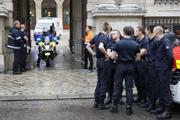 An ambulance leaves a building requisitioned to treat injured people, near the site of the accident at Parc Monceau in Paris,