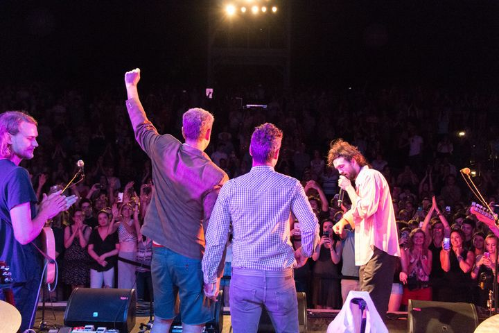 """Alex Ebert (right) and he and his bandmates considered canceling their show, but opted to""""rally the crowd instead by re"""
