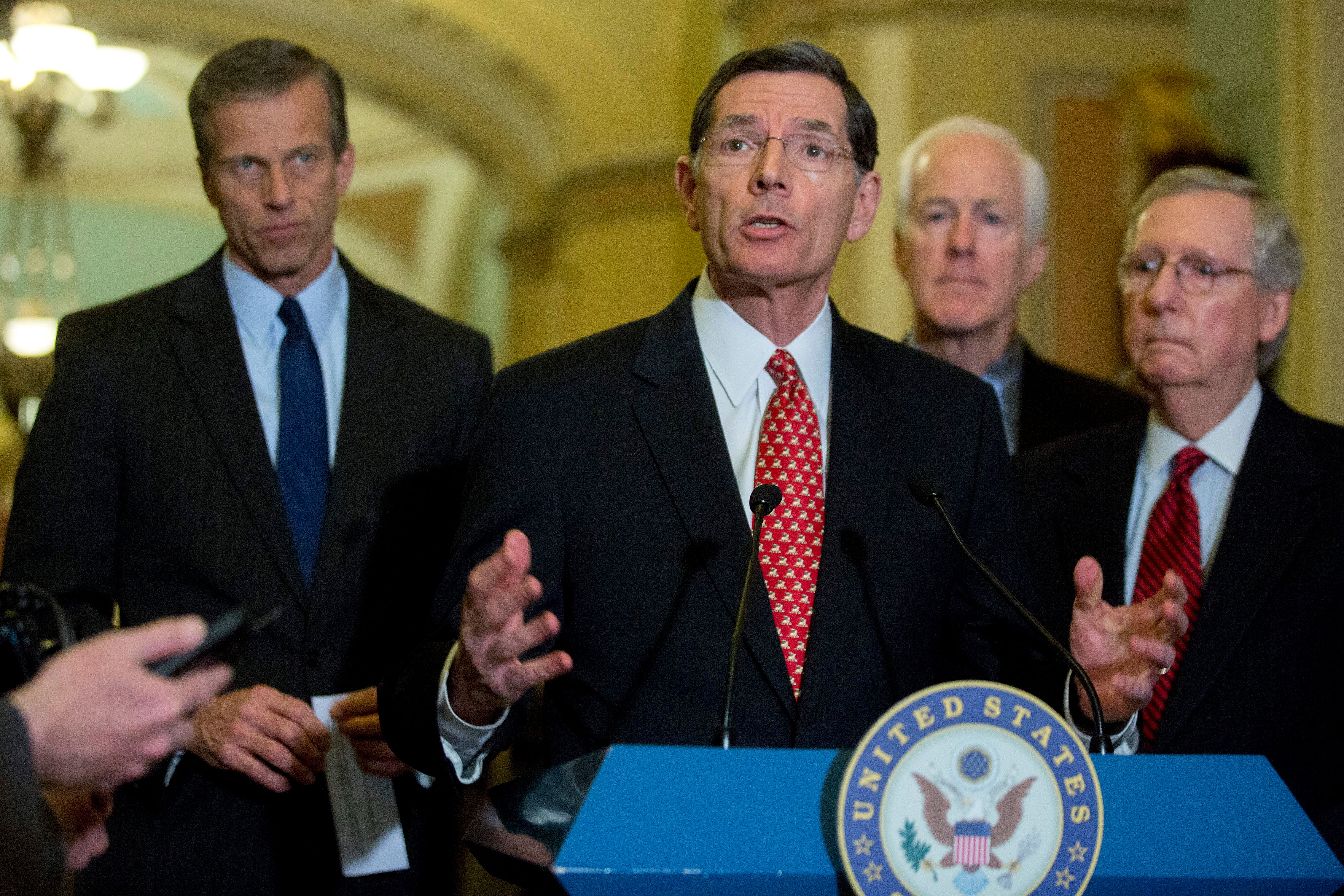 Senator John Barrasso, a Republican from Wyoming, center, speaks during a news conference following a Senate luncheon at the U.S. Capitol with John Thune, a Republican from South Dakota, from left, Barrasso, John Thune, a Republican from South Dakota, and Senate Majority Leader Mitch McConnell, a Republican from Kentucky, in Washington, D.C., U.S., on Tuesday, Feb. 24, 2015. Days before funding for the Department of Homeland Security expires, Senate Majority Leader Mitch McConnell is getting a mixed reaction to his plan to separate agency financing from opposition to President Barack Obama's immigration policies. Photographer: Andrew Harrer/Bloomberg via Getty Images