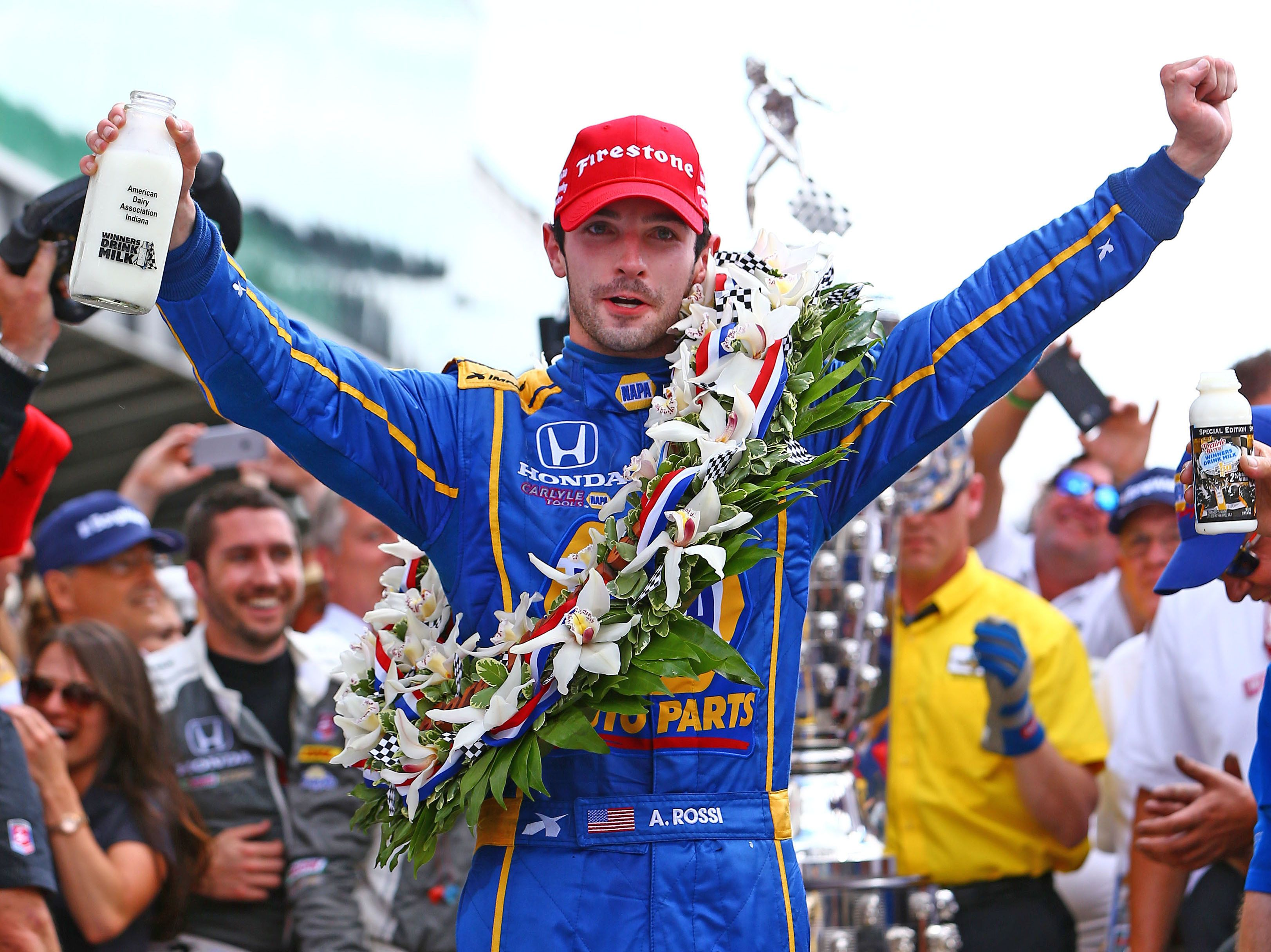IndyCar Series driver Alexander Rossi celebrates after winning the 100th running of the Indianapolis 500.