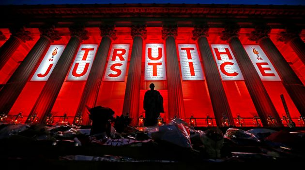 St George's Hall in Liverpool is illuminated following a special commemorative service to mark the outcome...