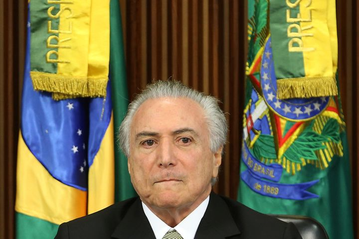 Brazil's interim President Michel Temer reacts during a meeting of the presentation of economic measures, at the Planalto Pal