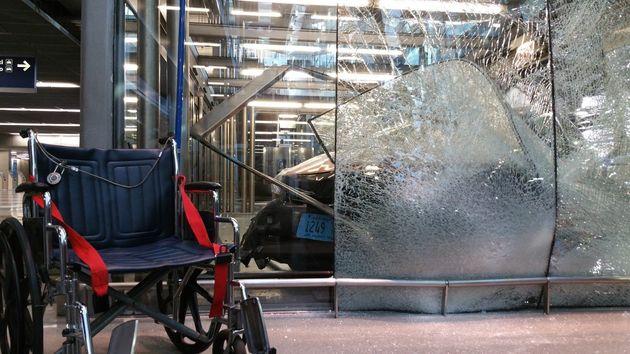 Taxi Slams Into O'Hare Terminal Entrance