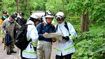People search for a seven-year-old boy who went missing two days earlier, in Nanae town on the northernmost Japanese main island of Hokkaido, Japan, in this photo taken by May 30, 2016. Mandatory credit Kyodo/via REUTERS  ATTENTION EDITORS - THIS IMAGE WAS PROVIDED BY A THIRD PARTY. EDITORIAL USE ONLY. MANDATORY CREDIT. JAPAN OUT. NO COMMERCIAL OR EDITORIAL SALES IN JAPAN. TPX IMAGES OF THE DAY