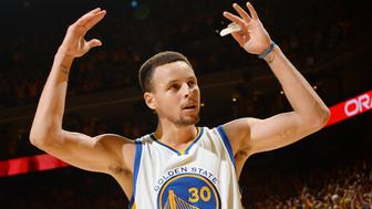 OAKLAND, CA - MAY 30:  Stephen Curry #30 of the Golden State Warriors pumps up the crowd during the game against the Oklahoma City Thunder in Game Seven of the Western Conference Finals during the 2016 NBA Playoffs on May 30, 2016 at ORACLE Arena in Oakland, California. NOTE TO USER: User expressly acknowledges and agrees that, by downloading and or using this photograph, user is consenting to the terms and conditions of Getty Images License Agreement. Mandatory Copyright Notice: Copyright 2016 NBAE (Photo by Noah Graham/NBAE via Getty Images)