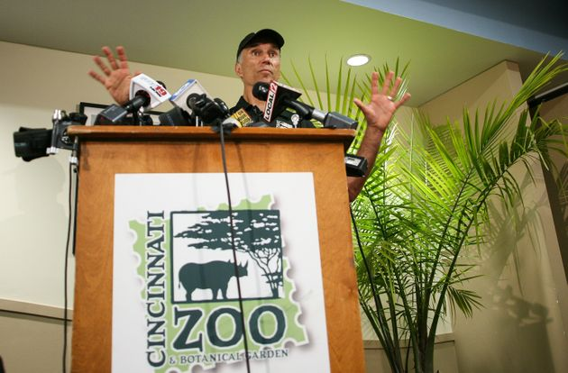 Thane Maynard, Executive Director of the Cincinnati Zoo and Botanical Gardens, speaks to reporters two...