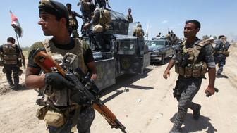 Iraqi security forces gather near Falluja, Iraq, May 31, 2016.  REUTERS/Alaa Al-Marjani