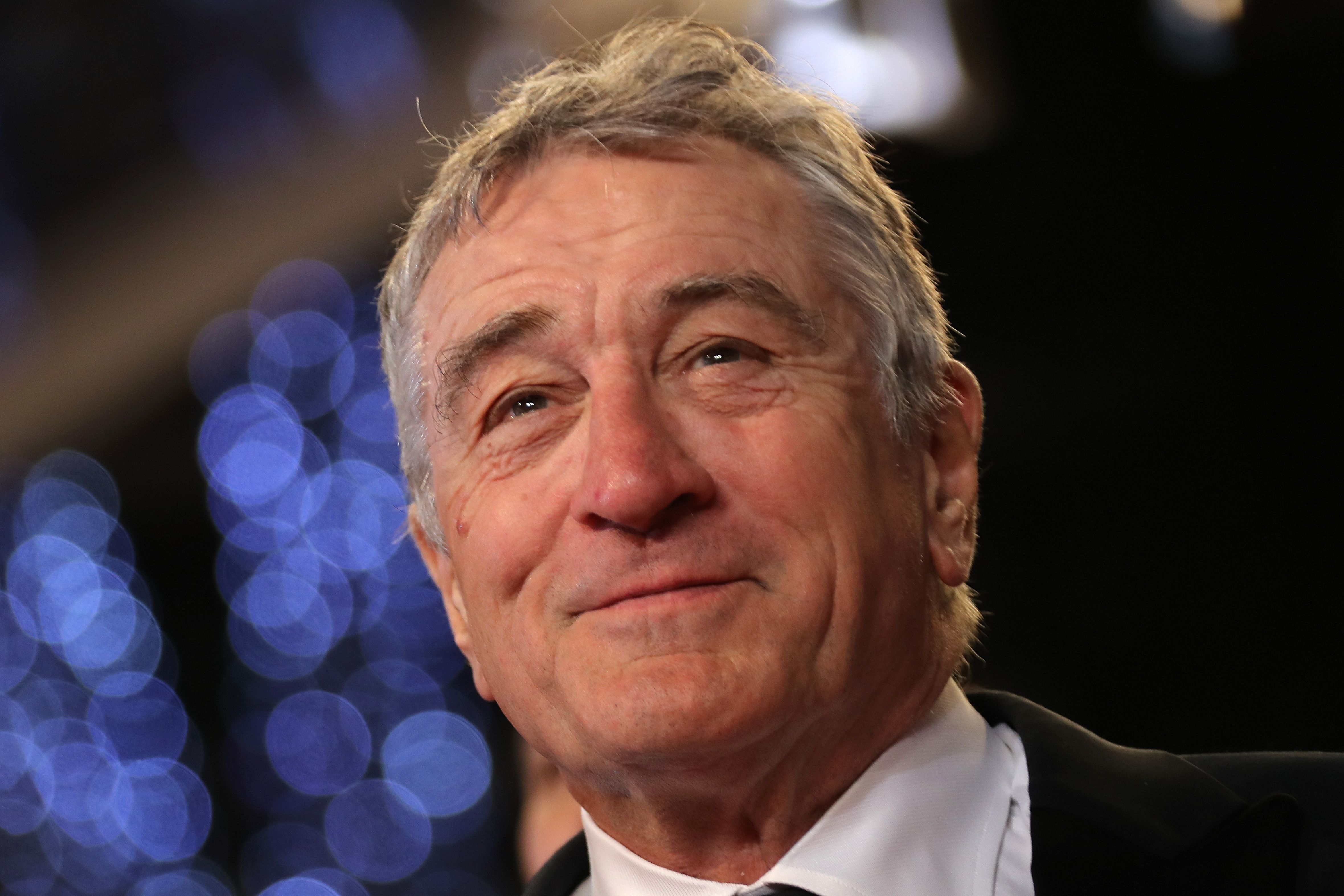 US actor Robert de Niro poses as he arrives on May 16, 2016 for the screening of the film 'Hands of Stone' at the 69th Cannes Film Festival in Cannes, southern France.  / AFP / Valery HACHE        (Photo credit should read VALERY HACHE/AFP/Getty Images)