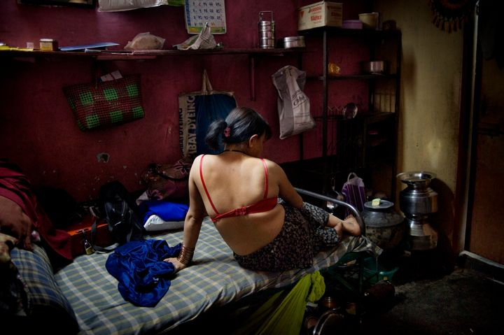 An HIV infected sex worker in a brothel in India. The women who work in this brothel may have between 20 to 50 customers per