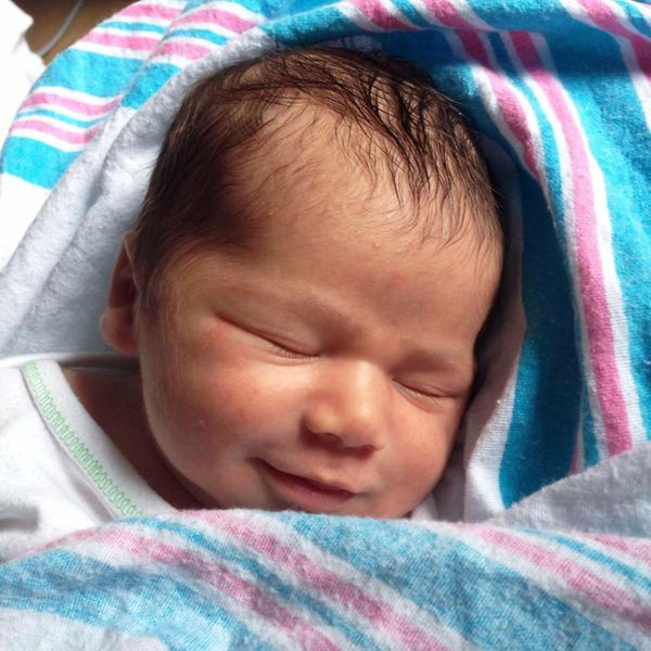 My son on the day he was born! Still that happy too...