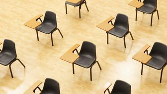 Desks in empty classroom