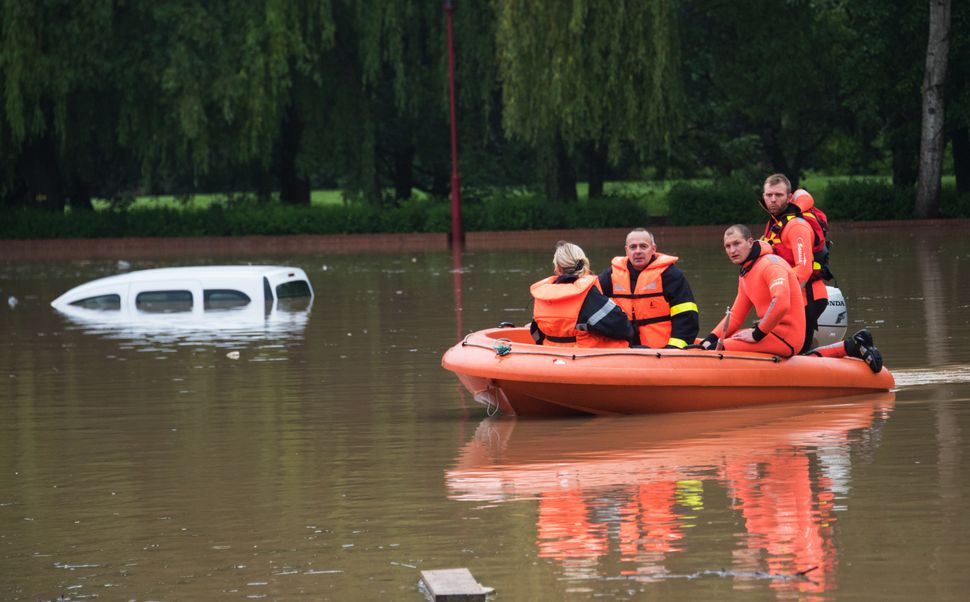 Rescuing firefighters patrol aboard a dinghy through the flooded town of Bruay-la-Buissiere, near Lens, northern France, on M