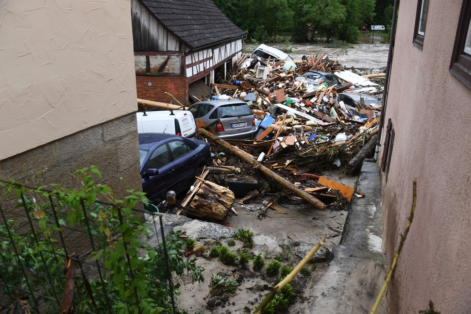 Cars stand amid rubbish in a flooded street in Braunsbach, southern Germany, on May 30, 2016. Four people died and several mo