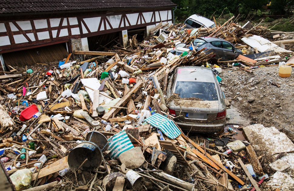 Cars are seen on May 31, 2016, amid rubble piled up by the floods after a thunderstorm in Braunsbach, southern Germany. Clean