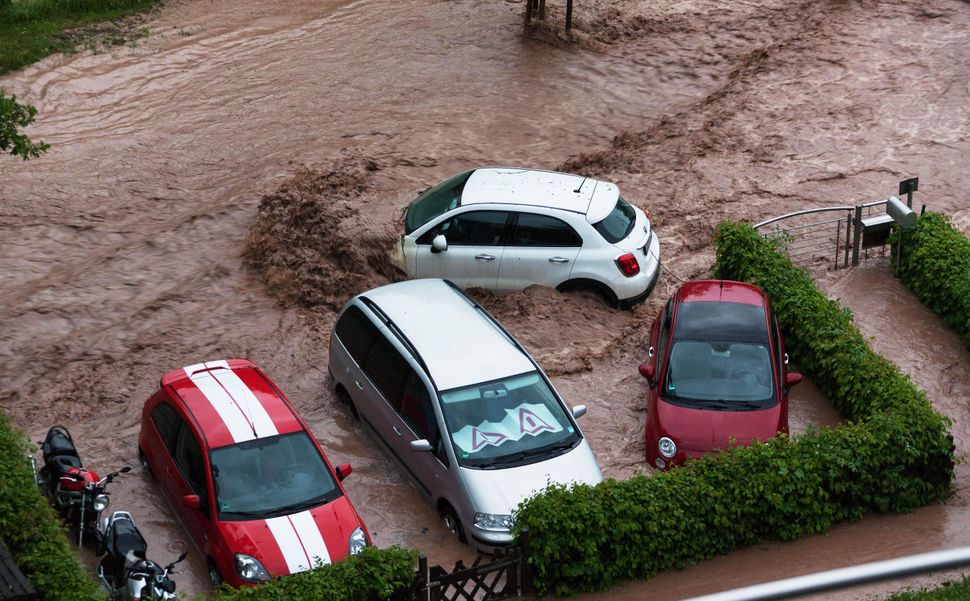 Cars are seen in a flooded street in Schwäbisch Gmünd, Baden-Württemberg, southern Germany, after heavy rains
