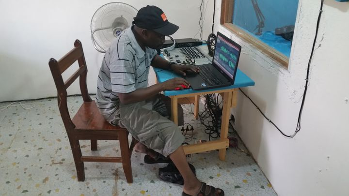 Journalists edit a message of peace to air on Voice of Ouaka in Bambari.
