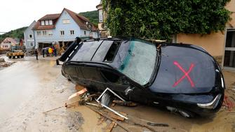 A damaged car is pictured after floods in the town of Braunsbach, Germany, May 30, 2016.  REUTERS/Kai Pfaffenbach