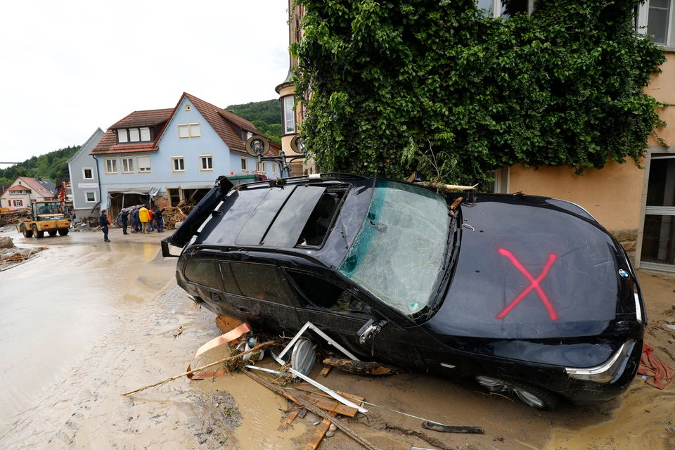 A damaged car is pictured Monday after floods in the town of Braunsbach,