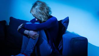 Embargoed to 2200 Wednesday May 25 PICTURE POSED BY MODEL File photo dated 09/03/15 of a woman showing signs of depression. More than half of young people who died by suicide had previously self-harmed, a report by the University of Manchester looking at dozens of deaths found.