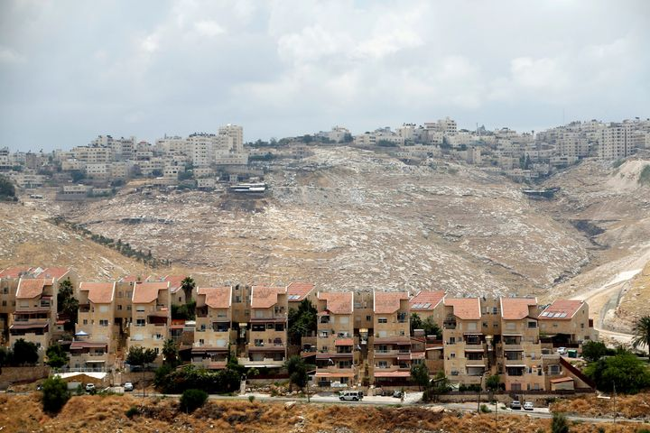 Houses are seen in the West Bank Jewish settlement of Maale Adumim as the Palestinian village of Al-Eizariya is seen in the b